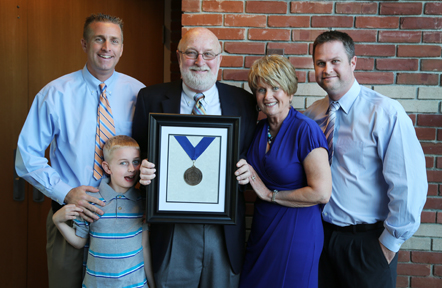 Dr. Joseph E. Bukowski (center) pictured with his family (left to right) son Scott; grandson Josh; wife, Donna; and son Chris during a reception held in his honor.
