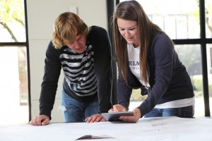 Photo caption (pictured left to right): Belmont College Civil Engineering students Mason Gulash and Anna Jones use their iPads in the classroom through the college's recent BEConnected initiative.