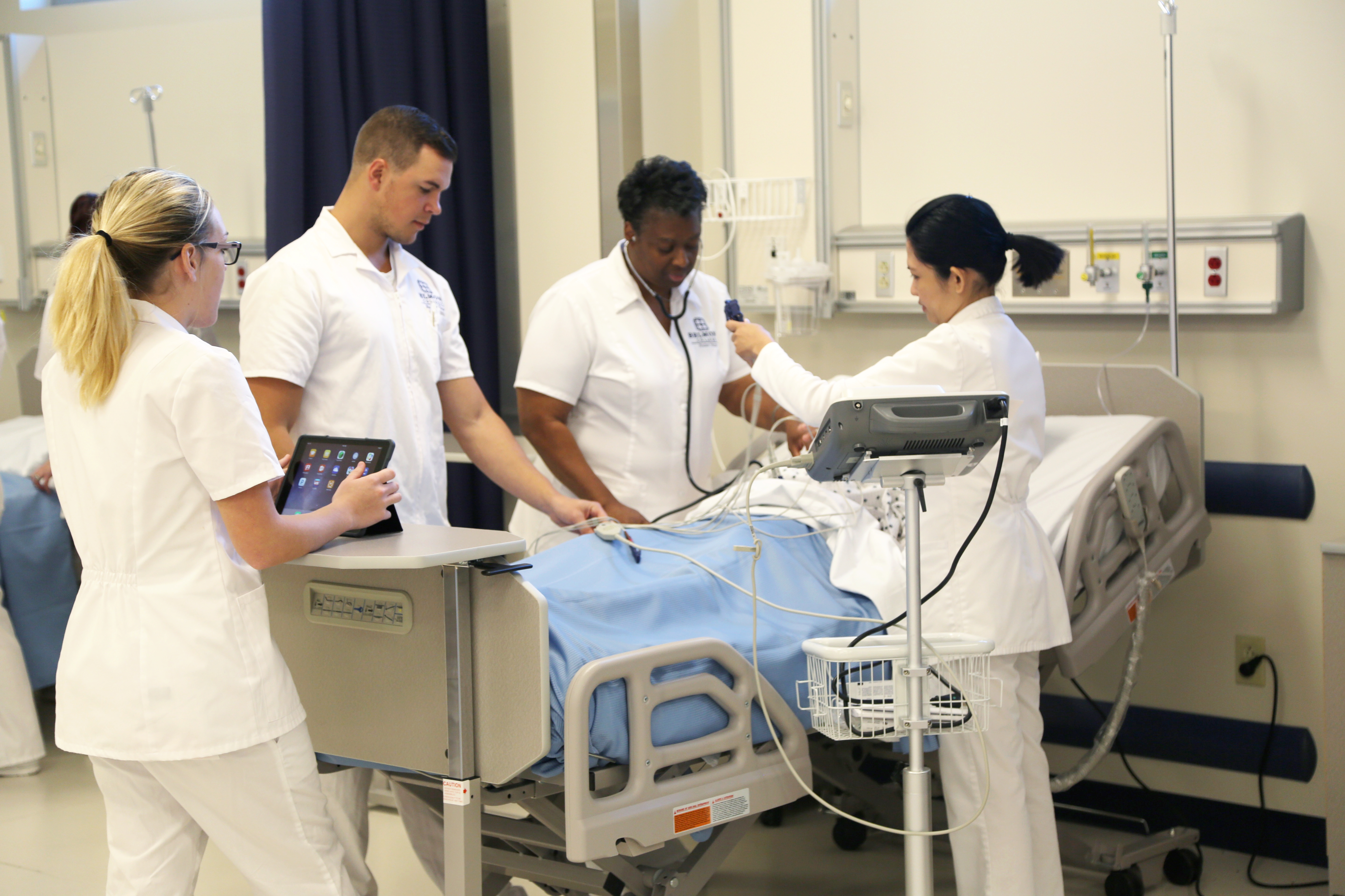 Pictured: Associate Degree Nursing students utilizing their iPads in class at the college's new Health Sciences Center; the use of iPads in the classroom facilitate how students and faculty generate content, collaborate, stay connected, and communicate both online and within the physical space of a classroom.