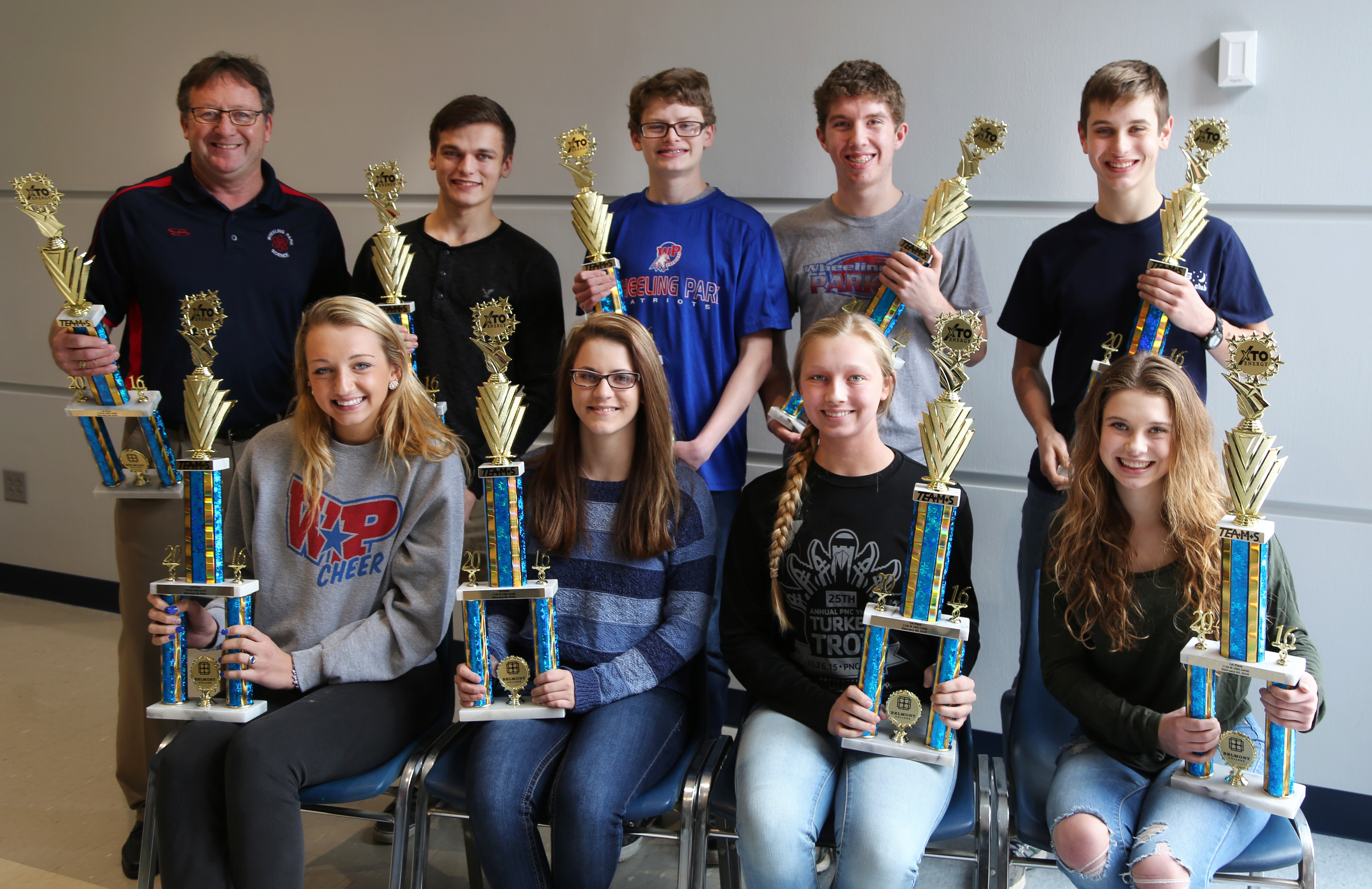 Photo Caption: 11th -12th Grade Varsity winners Wheeling Park High School Team A (seated left to right) Sydney Moffett; Kasey Freshwater; Lydia Russell; Miriam Demasi; (Standing left to right) Coach Pat Durkin; Nick Nestor; Zach Kovalski; Thomas Nagy; and William Sellers.
