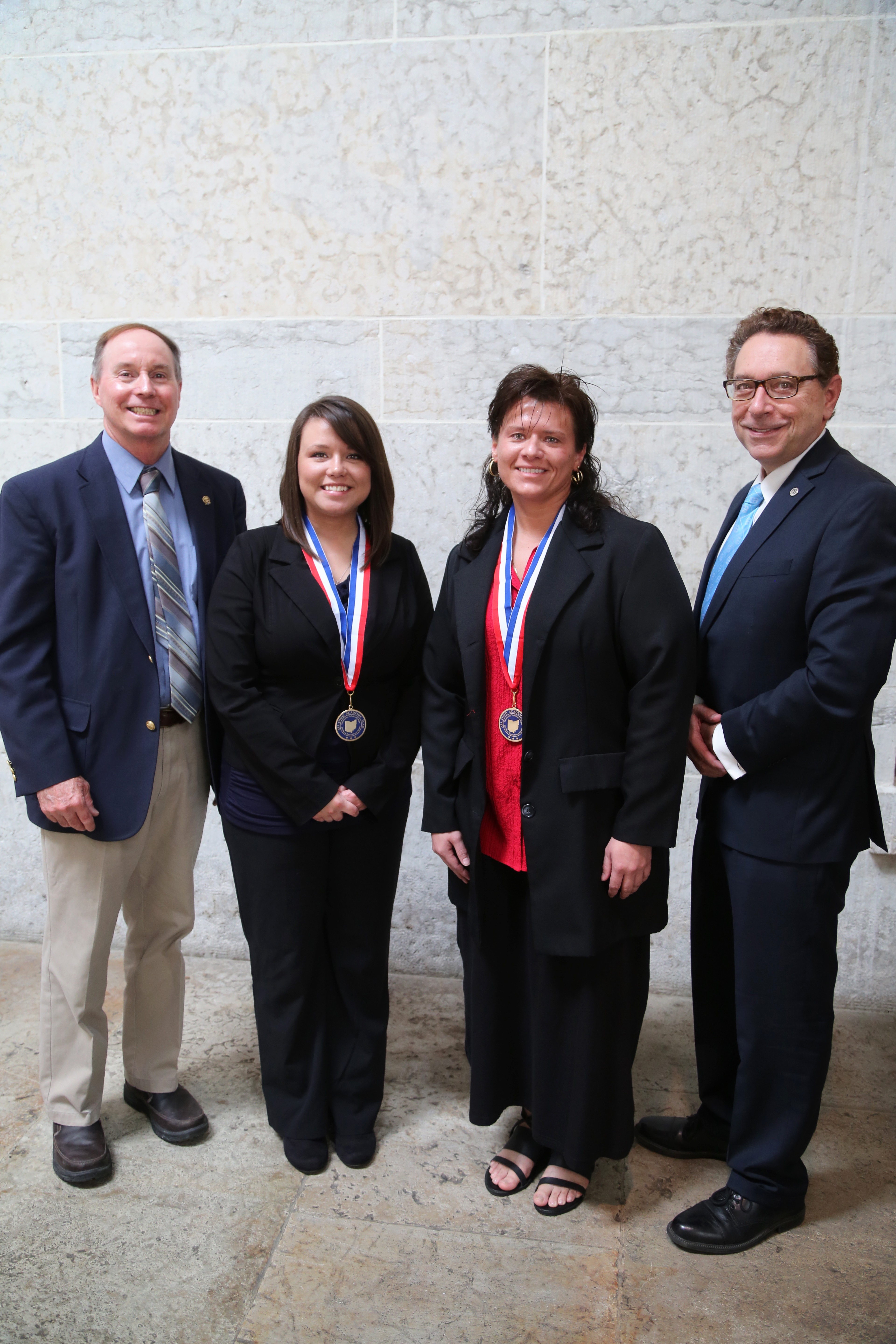 Pictured (left to right): Chuck Dawson, PTK Faculty Chair and Professor of Engineering, All-Ohio Academic Team Members Jenny Kurtzman and Cassandra Doolin, and Dr. Paul Gasparro, Belmont College President.