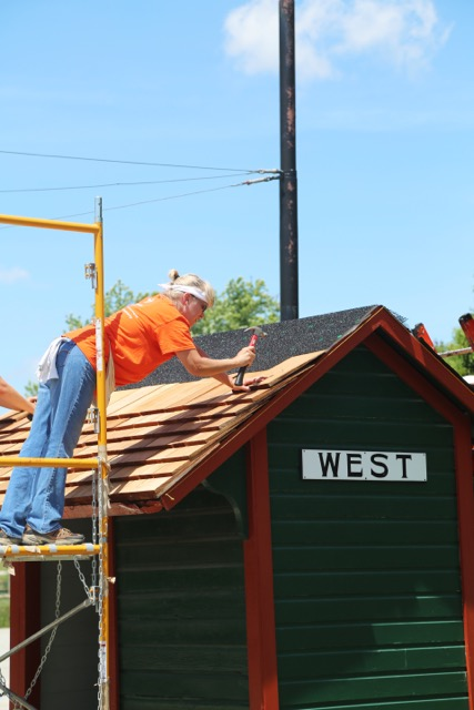 BPR student Susan Hinton from Uhrichsville, OH works to install new cedar shingles on the West trolley shelter at The Pennsylvania Trolley Museum in Washington, PA.