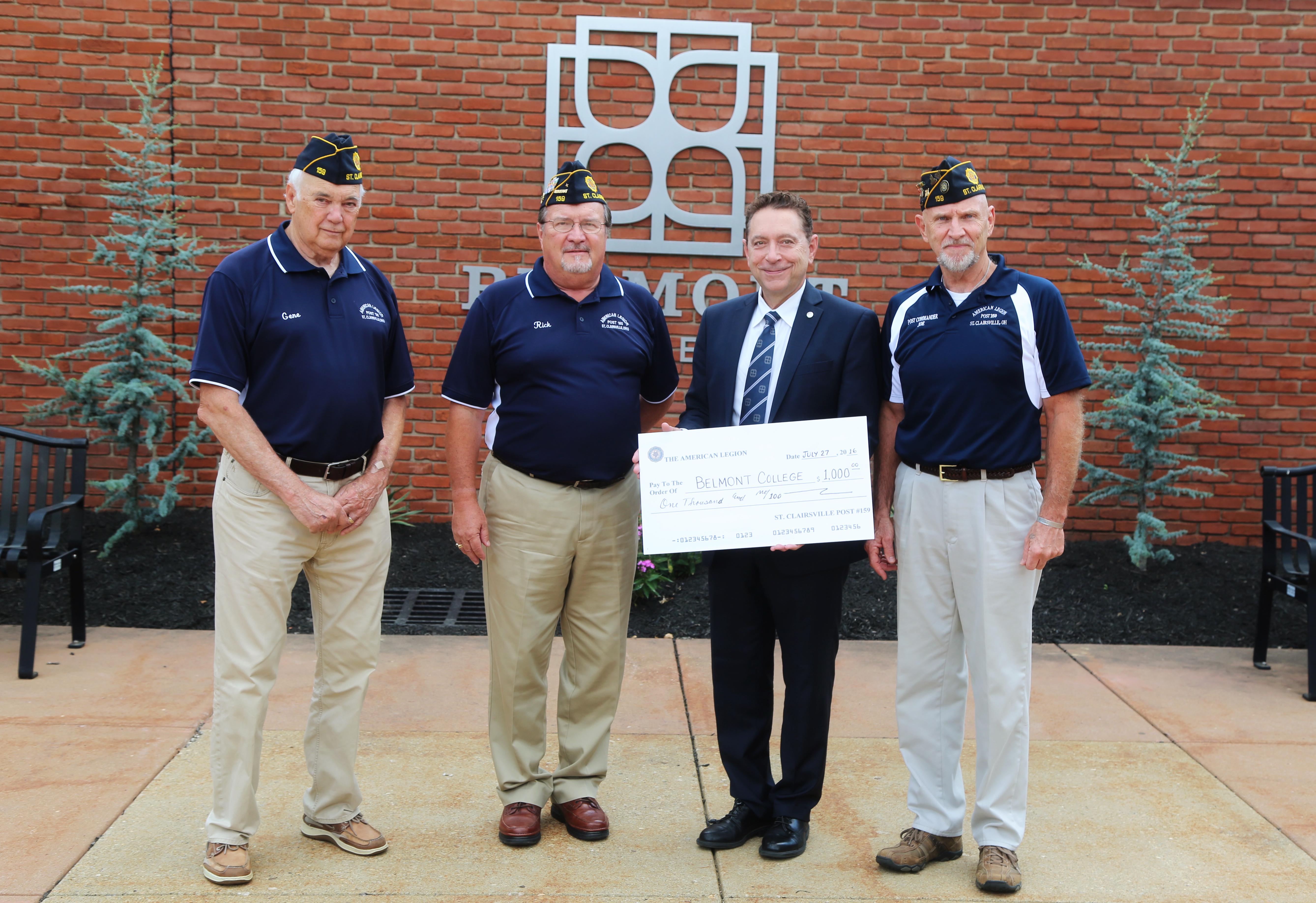 St. Clairsville American Legion Post #159 members present Dr. Paul Gasparro with the check to support the St. Clairsville American Legion Citizenship Scholarship. Pictured left to right are: Gene Kieffer, 1st Vice Commander; Rick Johnson, Post Adjutant; Dr. Paul Gasparro, Belmont College President; and Joe Barker, Commander.