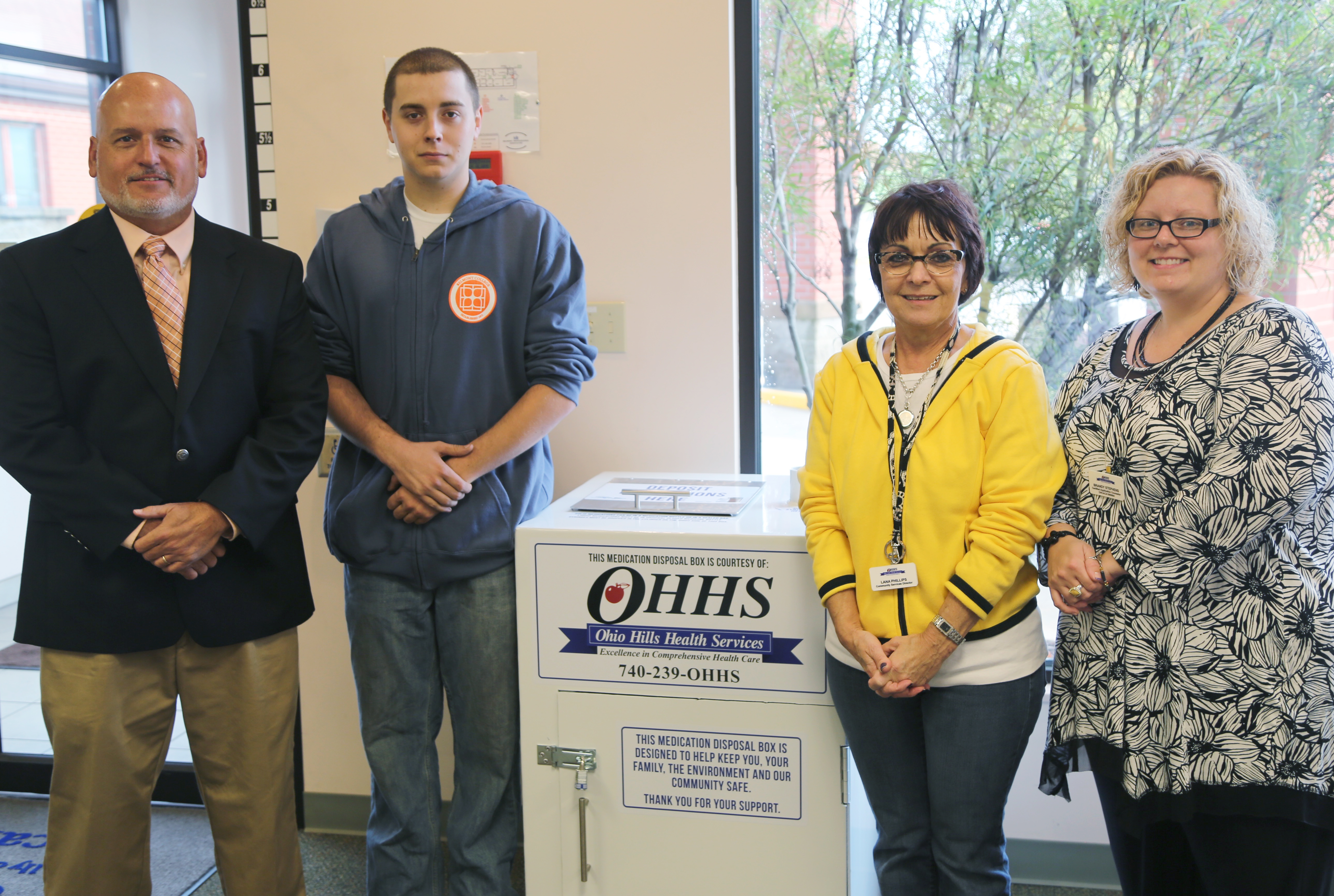 Photo caption: (from left to right) One of the most recently completed drug drop-off boxes was delivered to Morristown Pharmacy in Morristown, Ohio. Dirk DeCoy, Director of Industrial Trades and Contract Training; Nick Tobin, Belmont College Welding student; Lana Phillips, Community Services Director, Ohio Hills Health Services; and Brandy Stephens, Certified Application Counselor, Ohio Hills Health Services.