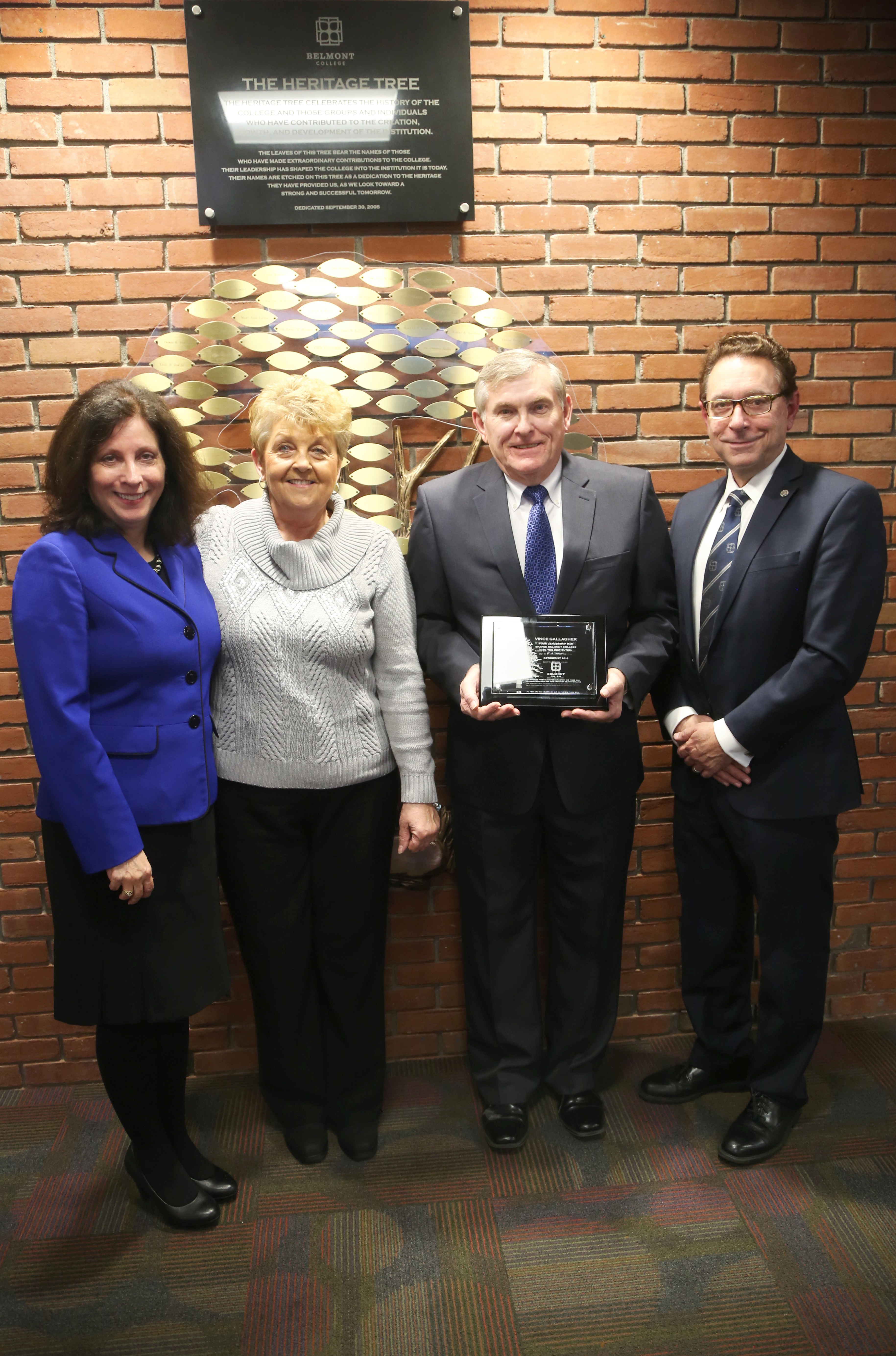 Photo caption (from left to right): Janet Jacobs, Foundation Board Chair; Mrs. Ann Gallagher; Mr. Vince Gallagher, Heritage Tree award recipient; and Dr. Paul Gasparro, Belmont College President.